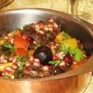 תבשיל בשר ראש כבש, תפוחים, רימונים ודבש תמרים