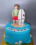 עוגת יום הולדת לגולש גלים עם הגלשן המקצועי שלו.