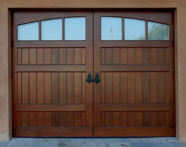faux wood garage door faux wood garage doors integrate the beauty and texture of natural wood with the energy efficiency of an insulated steel door