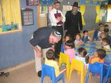 7.	Mr. Edmond Beck speaks with the children in a preschool class