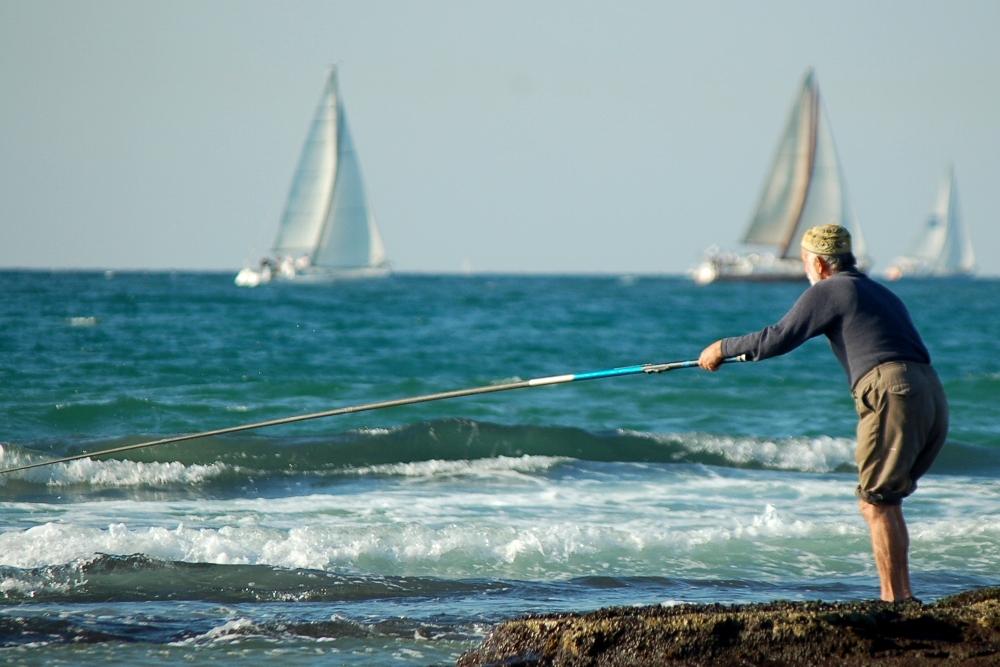 דייג בתל אביב  - תמונות בחינם ללקוחות Webfocus