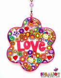 D30- מובייל אהבה, בסיס מחימר פולימרי לבן בצורת פרח ועליו פרחים, סמיילים, פרפרים ולבבות ובמרכזו המילה אהבה באותיות בולטות. בחלק ממרכזי הפרחים שקועות אבני קריסטל צבעוניות. (SOLD)