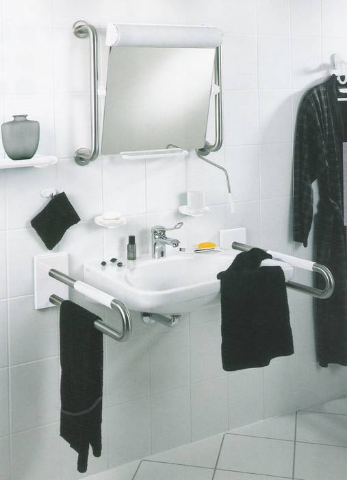 ידיות אחיזה קבועים ליד כיור רחצה-לבעלי מוגבלות.