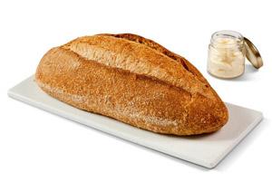 מבחר כיכרות לחמי מחמצת בתוספת צנצנת חמאה